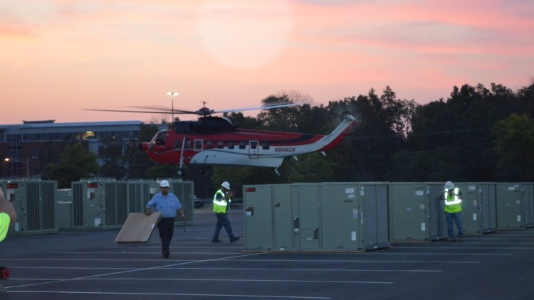 The Helicopter touches down and preparations begin for the lifts.