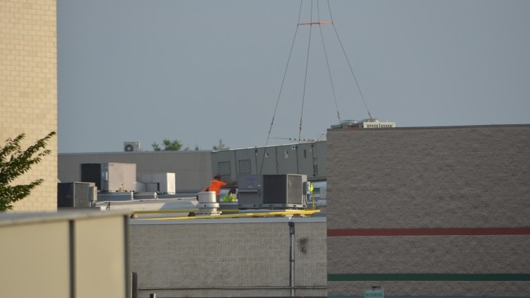 The rooftop crew hard at work.